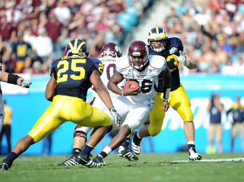 JACKSONVILLE, FL - JANUARY 01:  Quarterback Chris Relf #36 of the Mississippi State Bulldogs rushes against the Michigan Wolverines during the Gator Bowl at EverBank Field on January 1, 2011 in Jacksonville, Florida  (Photo by Rick Dole/Getty Images)