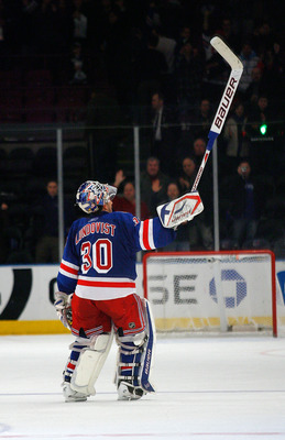 NEW YORK , NY - JANUARY 13: Winning goaltender Henrik Lundqvist #30 of the New York Rangers salutes the fans after being named the first star of the game after shuting out the Vancouver Canucks at Madison Square Garden on January 13, 2011 in New York City