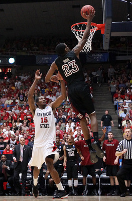 TUCSON, AZ - MARCH 19:  Ramone Moore #23 of the Temple Owls shoots over Kawhi Leonard #15 of the San Diego State Aztecs during the third round of the 2011 NCAA men's basketball tournament at McKale Center on March 19, 2011 in Tucson, Arizona.  (Photo by C