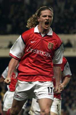 2 May 2000:  Emmanuel Petit of Arsenal celebrates scoring the winning goal in the last minute during the match between Arsenal and West Ham United in the FA Carling Premiership at Highbury, London.  Mandatory Credit: Laurence Griffiths/ALLSPORT