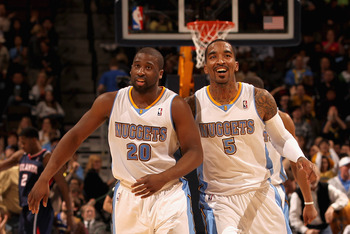 DENVER, CO - FEBRUARY 28:  Raymond Felton #20 and J.R. Smith #5 of the Denver Nuggets celebrate after connecting to score against the Atlanta Hawks during NBA action at the Pepsi Center on February 28, 2011 in Denver, Colorado. The Nuggets deafeated the H