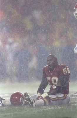 4 Oct 1998:  Outside lineback Derrick Thomas #58 of the Kansas City Chiefs sits on the field in the rain during a game against the Seattle Seahawks at the Arrowhead Stadium in Kansas City, Missouri. The Chiefs defeated the Seahawks 17-6.