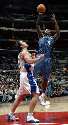 LOS ANGELES - MARCH 25:  Kwame Brown #5 of the Washington Wizards shoots over Zeljko Rebraca #11 of the Los Angeles Clippers on March 25, 2005 at Staples Center in Los Angeles, California. The Clippers defeated the Wizards 98-94.  NOTE TO USER: User expre