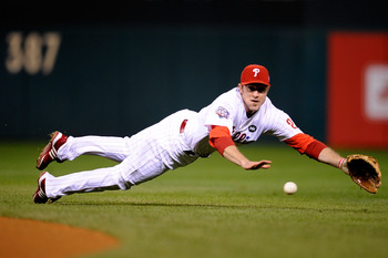 PHILADELPHIA - NOVEMBER 01:  Chase Utley #26 of the Philadelphia Phillies fails to make a play on an infield single hit by Derek Jeter #2 of the New York Yankees in the top of the first inning of Game Four of the 2009 MLB World Series at Citizens Bank Par