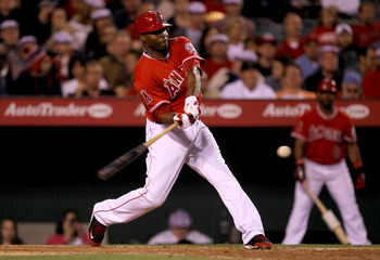 ANAHEIM, CA - JUNE 7:  Torii Hunter #48 of the Los Angeles Angels of Anaheim hits an RBI single in the sixth inning against the Tampa Bay Rays on June 7, 2011 at Angel Stadium in Anaheim, California.  (Photo by Stephen Dunn/Getty Images)