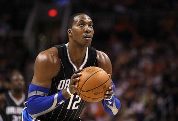 PHOENIX, AZ - MARCH 13:  Dwight Howard #12 of the Orlando Magic shoots a free throw shot against the Phoenix Suns during the NBA game at US Airways Center on March 13, 2011 in Phoenix, Arizona.  NOTE TO USER: User expressly acknowledges and agrees that, b