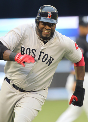 TORONTO, CANADA - JUNE 11:  David Ortiz #34 of the Boston Red Sox rounds the bases against the Toronto Blue Jays in a MLB game on June 11, 2011 at the Rogers Centre in Toronto, Ontario, Canada.  (Photo by Claus Andersen/Getty Images)
