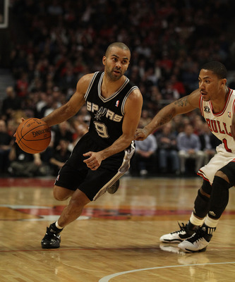 CHICAGO, IL - FEBRUARY 17: Tony Parker #9 of the San Antonio Spurs moves past Derrick Rose #1 of the Chicago Bulls at the United Center on February 17, 2011 in Chicago, Illinois. The Bulls defeated the Spurs 109-99. NOTE TO USER: User expressly acknowledg