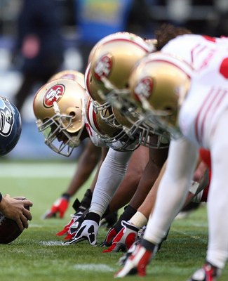 SEATTLE - DECEMBER 6:  The San Francisco 49ers defense lines up against the Seattle Seahawks offense during their NFL game on December 6, 2009 at Qwest Field in Seattle, Washington. The Seahawks defeated the 49ers 20-17. (Photo by Otto Greule Jr./Getty Im