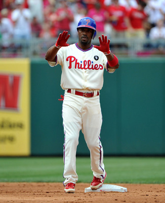 PHILADELPHIA - JUNE 26: Jimmy Rollins #11 of the Philadelphia Phillies asks for time out after hitting a double in the bottom of the second inning against the Oakland Athletics at Citizens Bank Park on June 26, 2011 in Philadelphia, Pennsylvania. (Photo b