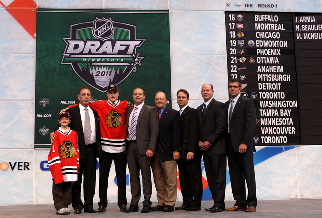 ST PAUL, MN - JUNE 24:  Eighteenth overall pick Mark McNeill by the Chicago Blackhawks stands onstage with members of the Chicago Blackhawks organization during day one of the 2011 NHL Entry Draft at Xcel Energy Center on June 24, 2011 in St Paul, Minneso