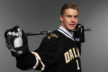 ST PAUL, MN - JUNE 24:  14th overall pick Jamieson Oleksiak by the Dallas Stars poses for a portrait during day one of the 2011 NHL Entry Draft at Xcel Energy Center on June 24, 2011 in St Paul, Minnesota.  (Photo by Nick Laham/Getty Images)