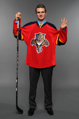 ST PAUL, MN - JUNE 24: (EDITOR'S NOTE: This image has been digitally altered) Third overall pick Jonathan Huberdeau by the Florida Panthers poses for a photo portrait during day one of the 2011 NHL Entry Draft at Xcel Energy Center on June 24, 2011 in St