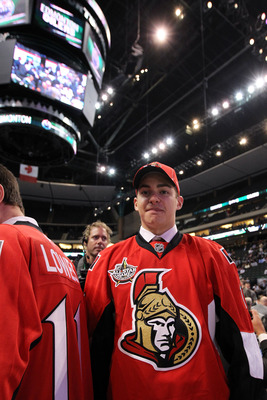 ST PAUL, MN - JUNE 25:  61st overall pick 	Shane Prince by the Ottawa Senators looks on from the draft floor during day two of the 2011 NHL Entry Draft at Xcel Energy Center on June 25, 2011 in St Paul, Minnesota.  (Photo by Bruce Bennett/Getty Images)