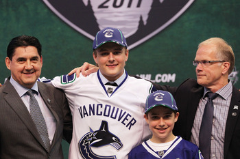 ST PAUL, MN - JUNE 24:  29th overall pick Nicklas Jensen by the Vancouver Canucks stands onstage for a photo with members of the Vancouver Canucks organization during day one of the 2011 NHL Entry Draft at Xcel Energy Center on June 24, 2011 in St Paul, M