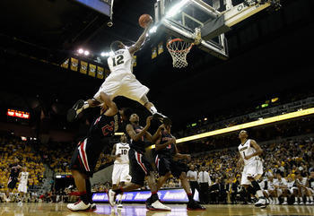 COLUMBIA, MO - FEBRUARY 15:  Marcus Denmon #12 of the Missouri Tigers leaps over Texas Tech Red Raiders defenders on his way toward scoring during the game on February 15, 2011 at Mizzou Arena in Columbia, Missouri.  (Photo by Jamie Squire/Getty Images)
