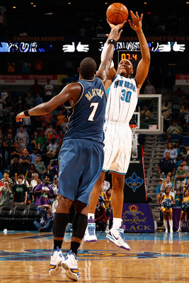 NEW ORLEANS - MARCH 31:  David West #30 of the New Orleans Hornets shoots the ball over Andray Blatche #7 of the Washington Wizards at New Orleans Arena on March 31, 2010 in New Orleans, Louisiana.  The Wizards defeated the Hornets 96-91.  NOTE TO USER: U