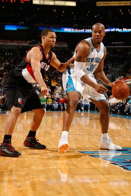 NEW ORLEANS - NOVEMBER 13:  David West #30  of the New Orleans Hornets drives the ball around Brandon Roy #7 of the Portland Trail Blazers at the New Orleans Arena on November 13, 2009 in New Orleans, Louisiana.  NOTE TO USER: User expressly acknowledges