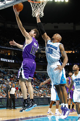 NEW ORLEANS, LA - DECEMBER 15:  Beno Udrih #19 of the Sacramento Kings shoots the ball over David West #30 of the New Orleans Hornets  at the New Orleans Arena on December 15, 2010 in New Orleans, Louisiana.  The Hornets defeated the Kings 94-91.  NOTE TO