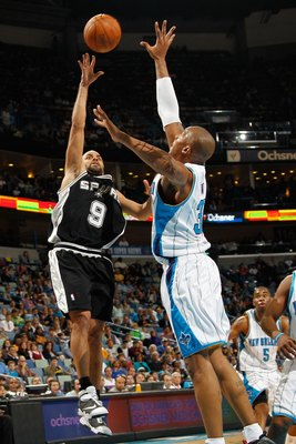 NEW ORLEANS - JANUARY 18:  Tony Parker #9 of the San Antonio Spurs shoots the ball over  David West #30 of the New Orleans Hornets at New Orleans Arena on January 18, 2010 in New Orleans, Louisiana.   NOTE TO USER: User expressly acknowledges and agrees t