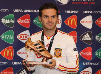 ARHUS, DENMARK - JUNE 25:  Juan Mata  of Spain receives the bronze boot after the UEFA European Under-21 Championship Final match between Spain and Switzerland at the Arhus Stadium on June 25, 2011 in Arhus, Denmark.  (Photo by Michael Steele/Getty Images