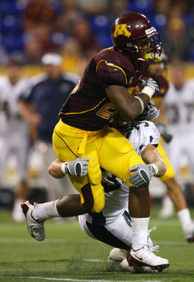 MINNEAPOLIS - SEPTEMBER 13:  Running back DeLeon Eskridge #23 of the Minnesota Golden Gophers is tackled by Jeff Price #34 of the Montana State Bobcats in fourth quarter at the Metrodome on September 13, 2008 in Minneapolis, Minnesota. Minnesota defeated