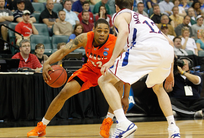 TULSA, OK - MARCH 20:  Demetri McCamey #32 of the Illinois Fighting Illini drives with the ball against Brady Morningstar #12 of the Kansas Jayhawks during the third round of the 2011 NCAA men's basketball tournament at BOK Center on March 20, 2011 in Tul