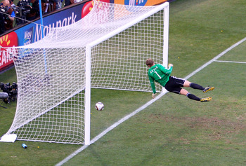 BLOEMFONTEIN, SOUTH AFRICA - JUNE 27:  Manuel Neuer of Germany watches the ball bounce over the line from a shot that hit the crossbar from Frank Lampard of England, but referee Jorge Larrionda judges the ball did not cross the line during the 2010 FIFA W