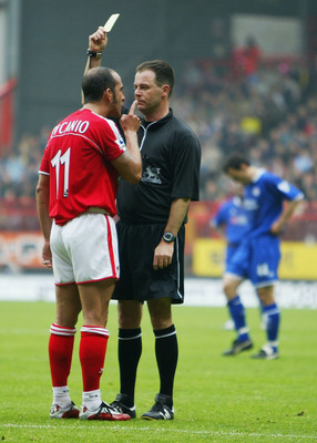 LONDON - MAY 1:  Paolo Di Canio of Charlton Athletic (L) argues with referee Rob Styles as he recieves a yelow card during the FA Barclaycard Premiership match between Charlton Athletic and Leicester City at The Valley on May 1, 2004 in London.  (Photo by