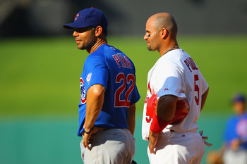 ST. LOUIS, MO - JUNE 4: Carlos Pena #22 of the Chicago Cubs and Albert Pujols #5 of the St. Louis Cardinals stand on first base at Busch Stadium on June 4, 2011 in St. Louis, Missouri.  The Cardinals beat the Cubs 5-4 in 12 innings.  (Photo by Dilip Vishw