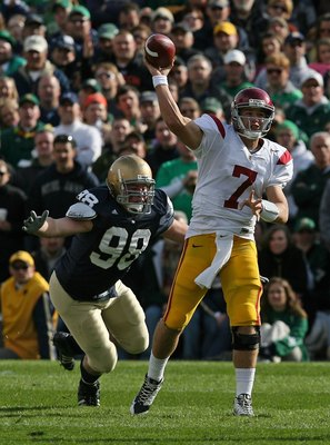 SOUTH BEND, IN - OCTOBER 17: Matt Barkley #7 of the USC Trojans throws a pass as Sean Cwynar #98 of the Notre Dame Fighting Irish closes in at Notre Dame Stadium on October 17, 2009 in South Bend, Indiana. USC defeated Notre Dame 34-27. (Photo by Jonathan
