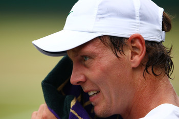 LONDON, ENGLAND - JUNE 24:  Tomas Berdych of the Czech Republic wipes his face with a towel during his third round match against Alex Bogomolov Jr. of the United States on Day Five of the Wimbledon Lawn Tennis Championships at the All England Lawn Tennis