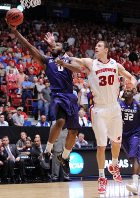 TUCSON, AZ - MARCH 19:  Jacob Pullen #0 of the Kansas State Wildcats shoots past Jon Leuer #30 of the Wisconsin Badgers during the third round of the 2011 NCAA men's basketball tournament at McKale Center on March 19, 2011 in Tucson, Arizona.  (Photo by H