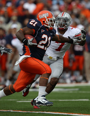 CHAMPAIGN, IL - OCTOBER 02: Jason Ford #21 of the Illinois Fighting Illini runs past Jermale Hines #7 of the Ohio State Buckeyes at Memorial Stadium on October 2, 2010 in Champaign, Illinois. Ohio State defeated Illinois 24-13. (Photo by Jonathan Daniel/G