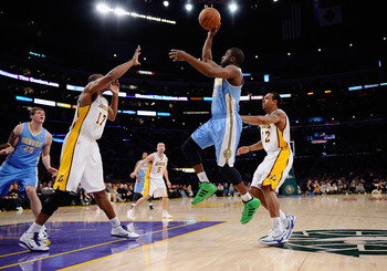 LOS ANGELES, CA - APRIL 03:  Raymond Felton #20 of the Denver Nuggets shoots over Andrew Bynum #17 and Shannon Brown #12 of the Los Angeles Lakers during the game at Staples Center on April 3, 2011 in Los Angeles, California. NOTE TO USER: User expressly