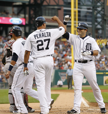 DETROIT - JUNE 25: Alex Avila #13 of the Detroit Tigers celebrates after hitting a three-run home run in the fourth inning scoring Jhonny Peralta #27 and Victor Martinez #41 during the game at Comerica Park on June 25, 2011 in Detroit, Michigan.  (Photo b