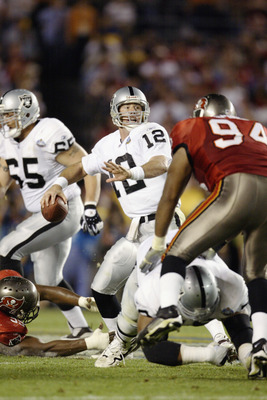 SAN DIEGO - JANUARY 26:  Rich Gannon #12 of the Oakland Raiders looks to pass under pressure from the Tampa Bay Buccaneers defense during Super Bowl XXXVII on January 26, 2003 at Qualcomm Stadium in San Diego, California.  The Buccaneers defeated the Raid