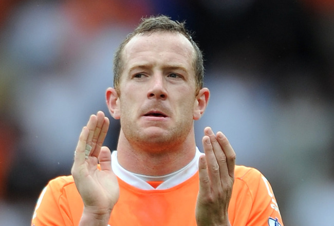 BLACKPOOL, ENGLAND - APRIL 23:  Charlie Adam of Blackpool applauds the supporters at full-time following the Barclays Premier League match between Blackpool and Newcastle United at Bloomfield Road on April 23, 2011 in Blackpool, England.  (Photo by Chris