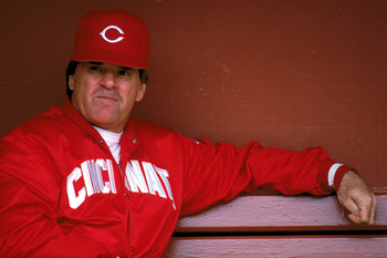 SAN FRANCISCO - 1989:  Manager Pete Rose #14 of the Cincinnati Reds sits in the dugout during the game against the San Francisco Giants at Candlestick Park during the 1989 MLB season in San Francisco, California.  (Photo by Otto Greule Jr./Getty Images)
