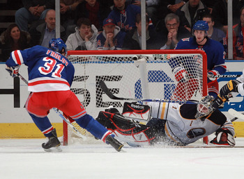 NEW YORK - NOVEMBER 11: Jhonas Enroth #1 of the Buffalo Sabres makes the save on Alexander Frolov #31 of the New York Rangers on November 11, 2010 in New York City. The Rangers defeated the Sabres 3-2 in overtime. (Photo by Bruce Bennett/Getty Images)