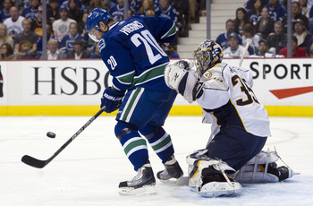 VANCOUVER, CANADA - APRIL 28: Chris Higgins #20 of the Vancouver Canucks tries to redirect the puck past goalie Pekka Rinne #35 of the Nashville Predators during the second period in Game One of the Western Conference Semifinals during the 2011 NHL Stanle