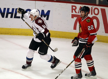 CHICAGO, IL - DECEMBER 15: Tomas Fleischmann #14 of the Colorado Avalanche celebrates his third goal of the game, all scored in the 3rd period, as he skates past Troy Brouwer #22 of the Chicago Blackhawks at the United Center on December 15, 2010 in Chica