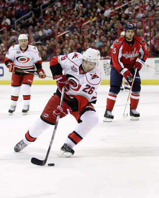 WASHINGTON, DC - MARCH 29:  Erik Cole #26 of the Carolina Hurricanes skates with the puck against the Washington Capitals at the Verizon Center on March 29, 2011 in Washington, DC.  (Photo by Rob Carr/Getty Images)