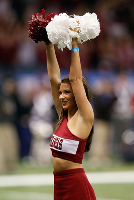 NEW ORLEANS, LA - JANUARY 04:  An Arkansas Razorbacks cheerleader performs during a break in the game against the Ohio State Buckeyes during the Allstate Sugar Bowl at the Louisiana Superdome on January 4, 2011 in New Orleans, Louisiana.  (Photo by Kevin