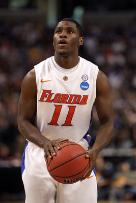 TAMPA, FL - MARCH 19:  Erving Walker #11 of the Florida Gators gets set to attempt a free throw against the UCLA Bruins during the third round of the 2011 NCAA men's basketball tournament at St. Pete Times Forum on March 19, 2011 in Tampa, Florida. Florid