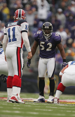 BALTIMORE - OCTOBER 24:  Ray Lewis #52 of the Balitmore Ravens lines up against Drew Bledsoe #11 of the Buffalo Bills at M&T Bank Stadium on October 24, 2004 in Baltimore, Maryland. The Ravens defeated the Bills 20-6. (Photo by Doug Pensinger/Getty Images