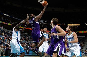 NEW ORLEANS, LA - DECEMBER 15:  Tyreke Evans #13 of the Sacramento Kings shoots the ball over Emeka Okafor #50 of the New Orleans Hornets  at the New Orleans Arena on December 15, 2010 in New Orleans, Louisiana.  The Hornets defeated the Kings 94-91.  NOT
