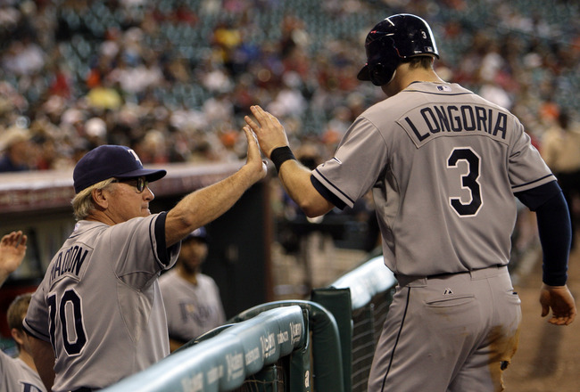 HOUSTON - JUNE 26:  Evan Longoria #3 of the Tampa Bay  Rays receives a high five from manager Joe Maddon #70 after hitting a home run in the sixth inning at Minute Maid Park on June 26, 2011 in Houston, Texas. The umpires reviewed the play and confimed ho