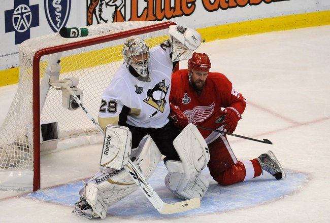 DETROIT - JUNE 12:  Goaltender Marc-Andre Fleury #29 of the Pittsburgh Penguins tries to avoid contact with Tomas Holmstrom #96 of the Detroit Red Wings during Game Seven of the 2009 NHL Stanley Cup Finals at Joe Louis Arena on June 12, 2009 in Detroit, M