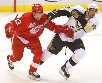 DETROIT - MAY 26:  Pavel Datsyuk #13 of the Detroit Red Wings and Sidney Crosby #87 of the Pittsburgh Penguins clash during game two of the 2008 NHL Stanley Cup Finals at Joe Louis Arena on May 26, 2008 in Detroit, Michigan. The Red Wings defeated the Pen